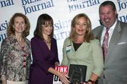 Sandy Bartow, president of the Jax Chamber Foundation (left), stands next to leadership consultant Leslie Grossman, Women of Influence honoree Lisa Robert of Reynolds, Smith & Hills and Anthony Kurlas, managing director of the North Florida market for Merrill Lynch.