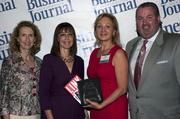 Sandy Bartow, president of the Jax Chamber Foundation (left), stands next to leadership consultant Leslie Grossman, Women of Influence honoree Helga van Eckert of the Flagler County Department of Economic Opportunity and Anthony Kurlas, managing director of the North Florida market for Merrill Lynch.