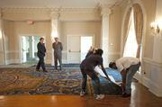 Crider and Jim Meyer, director of sales and marketing for the hotel, watched workers ripping out the old carpet.