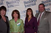 Candace Moody, chair of the Jacksonville Women's Business Center advisory board (left), stands next to Women of Influence honoree Jane Alred of 1st Place Sports, leadership consultant Leslie Grossman and Anthony Kurlas, managing director of the North Florida market for Merrill Lynch.