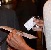 Business cards change hands all around the networking event.