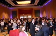 The networking crowd grows as the awards event approaches.