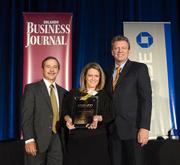 Ami Blakely, purchasing agent with Talismark, accepts her company's Ultimate Newcomers Award