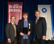 Justin Wetherill, president of uBreakiFix, accepts an Ultimate Newcomer Award.