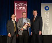 Randy Davis, chairman and CFO of Source 2 accepts his company's Ultimate Newcomer Award.