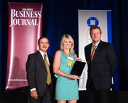 Leah Grieger, corporate VP of sales for Healthcare Support Staffing, accepts her company's Ultimate Newcomer Award.