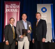 Craig Mateer, president of BAGS Inc., accepts his company's Ultimate Newcomer Award.