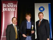uBreakiFix President Justin Wetherill accepts the award as the second fastest-growing company.