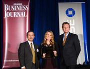 Montana Smith, public relations Coordinator with Sonny's Franchise Co. accepts her company's No. 7 spot award.