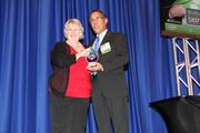 Mary Clark accepts the award for Sustainable Business on behalf of the University of New Mexico.