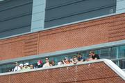 Fans line a balcony outside the Hilton to watch the practice runs.