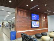 The first floor of the new ASU fitness building includes a lounge area with two TVs.