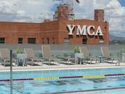 The student only pool on the fifth floor of the ASU Sun Devil Fitness Complex overlooks the older YMCA building.