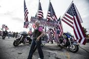The Harley with many American flags was a big hit in the parade.