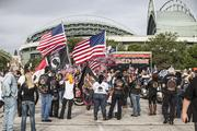 Harley riders waved their American flags before the parade.