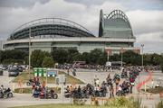 Bikers head out of Miller Park for the start of the parade.