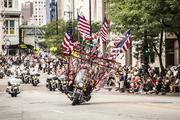 A motorcycle filled with American flags performed during the parade.