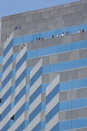 Fans watch the races from balconies downtown during the Grand Prix's final day.