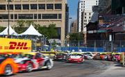 Cars collide in turn 1 early in the running of the IMSA GT3 Cup Challenge.