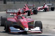 The Firestone Indy Lights race rounds turn 4.