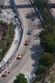 Cars head up Light Street during the 75-lap IZOD IndyCar Series on Sunday at the 2013 Grand Prix of Baltimore. The image was captured from the offices of Tydings & Rosenberg at 100 E. Pratt Street during a race day celebration. The event, in collaboration with ReliaSource and the Baltimore Festival of Speed, benefited the Wounded Warrior Project.