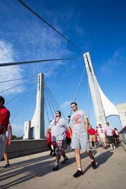 Three hours before game time, fans were streaming across the Lane Avenue bridge toward Ohio Stadium.