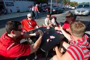 Another group of tailgaters passed the time playing poker. From left, Derek Fleming, Shad Foster, Phil Fleming, Bill Acton and Josh Eversman.
