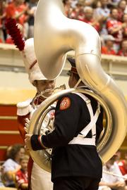 "Drum Major David Pettit congratulated sousaphone player Kyle Grossman, who was scheduled to dot the ""i"" during Script Ohio."