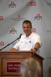 In the post-game news conference, coach Meyer flashed a rare smile after a 40-20 victory to open the season.
