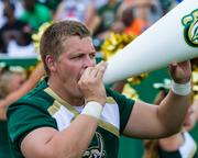 A Charlotte 49ers cheerleader chants to the crowd. The 49ers beat the Campbell Fighting Camels 52-7 in their inaugural football game at Jerry Richardson Stadium, on Aug. 31, 2013.