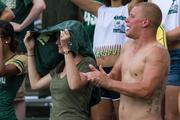One Charlotte 49ers fan gave his shirt to another for a rain cover during a brief shower during the second half.  The 49ers beat the Campbell Fighting Camels 52-7 in their inaugural football game at Jerry Richardson Stadium, on Aug. 31, 2013.