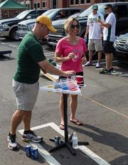 Charlotte 49ers fans play beer pong before the game. The 49ers beat the Campbell Fighting Camels 52-7 in their inaugural football game at Jerry Richardson Stadium, on Aug. 31, 2013.