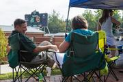 Charlotte 49ers fans tailgate before the game. The 49ers beat the Campbell Fighting Camels 52-7 in their inaugural football game at Jerry Richardson Stadium, on Aug. 31, 2013.