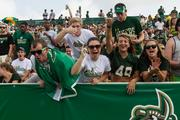 Charlotte 49ers fans show school spirit. The 49ers beat the Campbell Fighting Camels 52-7 in their inaugural football game at Jerry Richardson Stadium, on Aug. 31, 2013.