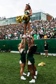 Charlotte 49ers cheerleaders wait for the first kickoff. The 49ers beat the Campbell Fighting Camels 52-7 in their inaugural football game at Jerry Richardson Stadium, on Aug. 31, 2013.