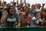 Some Charlotte 49ers fans couldn't keep their shirts on amid high temperatures and humidity. The 49ers beat the Campbell Fighting Camels 52-7 in their inaugural football game at Jerry Richardson Stadium, on Aug. 31, 2013.