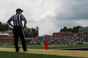 A game official looks over the field during a time out. The 49ers beat the Campbell Fighting Camels 52-7 in their inaugural football game at Jerry Richardson Stadium, on Aug. 31, 2013.