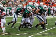 Charlotte 49ers running back Alan Barnwell races forward, accompanied by a posse of blockers. The 49ers beat the Campbell Fighting Camels 52-7 in their inaugural football game at Jerry Richardson Stadium, on Aug. 31, 2013.