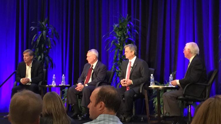 """Former Austin Mayors Will Wynn (left) and Lee Leffingwell (second from left) were joined by Mayor Steve Adler and moderator Neal Speice at the real estate """"Power Lunch"""" on Monday at the Hyatt Regency."""