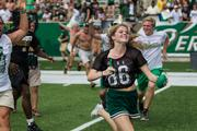 Student fans storm the field in celebration after the game. The 49ers beat the Campbell Fighting Camels 52-7 in their inaugural football game at Jerry Richardson Stadium, on Aug. 31, 2013.