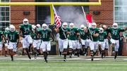 The Charlotte 49ers storm onto the field before kickoff. The 49ers beat the Campbell Fighting Camels 52-7 in their inaugural football game at Jerry Richardson Stadium, on Aug. 31, 2013.