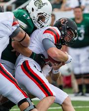 Charlotte 49ers linebacker Micah Bryan takes down quarterback Brian Hudson. The 49ers beat the Campbell Fighting Camels 52-7 in their inaugural football game at Jerry Richardson Stadium, on Aug. 31, 2013.