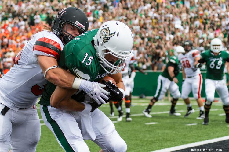 Charlotte 49ers H-back Justin Bolus catches a touchdown pass. The 49ers beat the Campbell Fighting Camels 52-7 in their inaugural football game at Jerry Richardson Stadium, on Aug. 31, 2013.