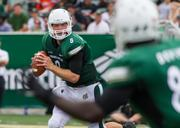 Charlotte 49ers quarterback Matt Johnson looks for a receiver. The 49ers beat the Campbell Fighting Camels 52-7 in their inaugural football game at Jerry Richardson Stadium, on Aug. 31, 2013.