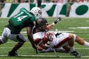 Charlotte 49ers cornerback Tank Norman makes a stop on Campbell wide receiver Jordan Hildreth. The 49ers beat the Fighting Camels 52-7 in their inaugural football game at Jerry Richardson Stadium, on Aug. 31, 2013.