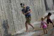 Adults and children enjoyed cooling off in the refreshing water feature, intended for water play.