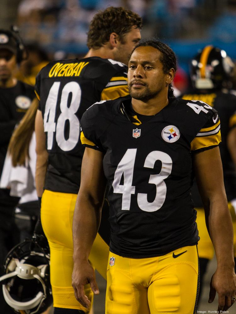 Pittsburgh Steelers safety Troy Polamalu paces the sidelines during an August 2013 preseason game vs. the Carolina Panthers at Bank of America Stadium in Charlotte. Huntley Paton
