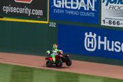 Homer the Dragon, mascot for the Charlotte Knights, pops some wheelies on an ATV during a break in the action on Monday.