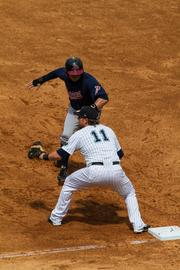 Charlotte Knights first baseman Travis Wilkins holds a runner on during the final game at Knights Stadium.