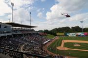 A helicopter descends on Knight Stadium in Fort Mill, S.C., after the game on Monday to take home plate and the bases from the facility to BB&T Ballpark in uptown Charlotte, which will be the Knights' new home starting in 2014.